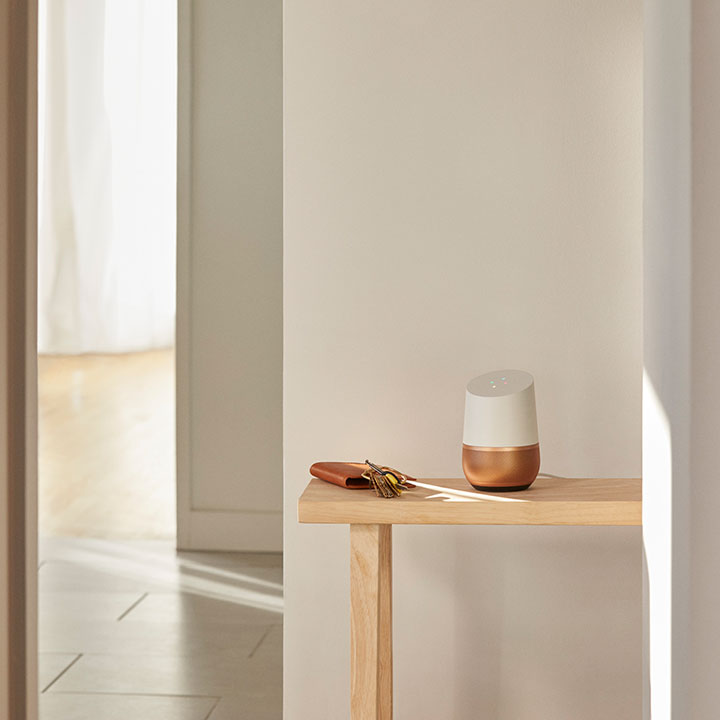 Google Home on table in a bright hallway
