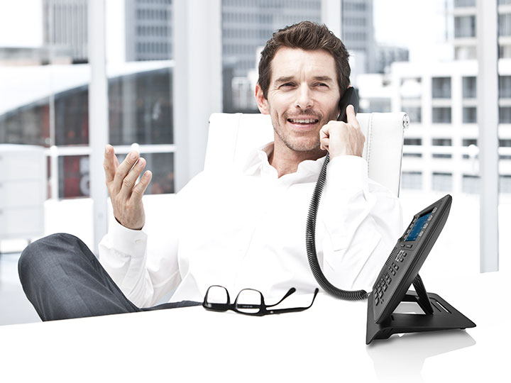 Man on the telefone within an office